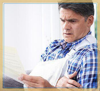 injured man concerned with insurance paperwork