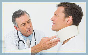 man with whiplash injury seeking treatment from doctor