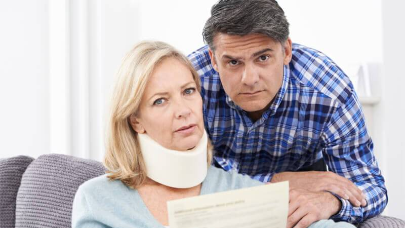 couple in need of whiplash lawyer