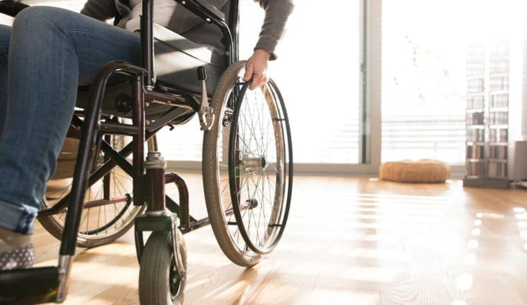 wheelchair-bound victim of spinal cord injury