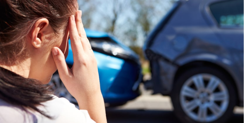 woman with a headache after being in a type of car crash