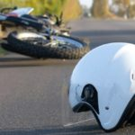 Motorcycle helmet on the road after a traumatic accident