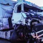Semi-truck with crushed front fender attests to how many truck accidents happen a year in Florida